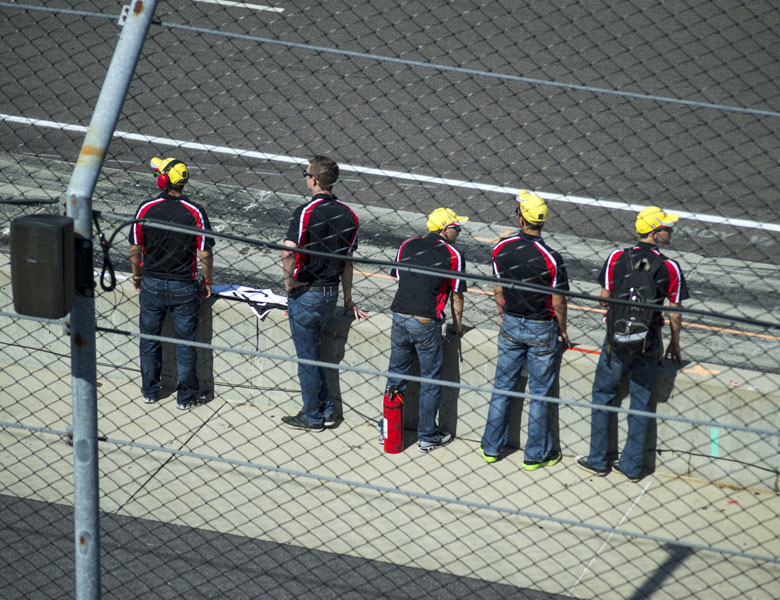 The guys eagerly await the arrival of their bright yellow Corvette during practice.