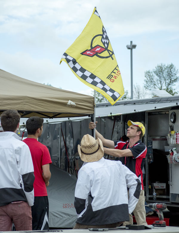 Back to the pits to finish setting up our pit space. The Corvette flag makes a wonderful finishing touch.