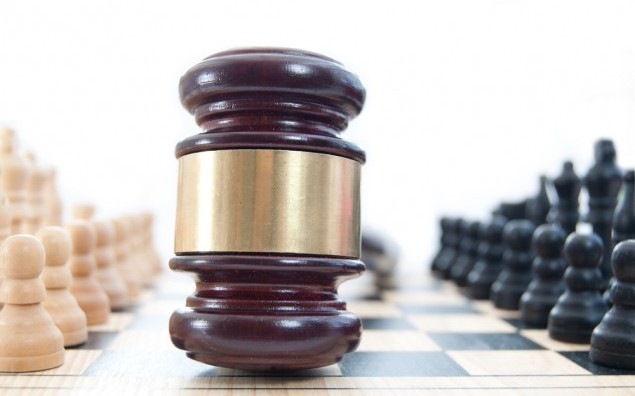 Judge's gavel on a chessboard