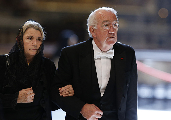 Ken Hackett, U.S. ambassador to the Holy See, arrives with his wife Joan for a Mass celebrated by Pope Francis in St. Peter's Basilica at the Vatican Nov. 4. The memorial Mass recalled the cardinals and bishops who died during the past year.