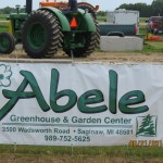 Abele Greenhouse - Sign on the fence