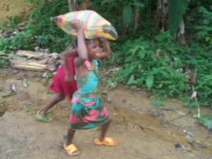 young girls carrying water away from springs in Kumba during water crisis