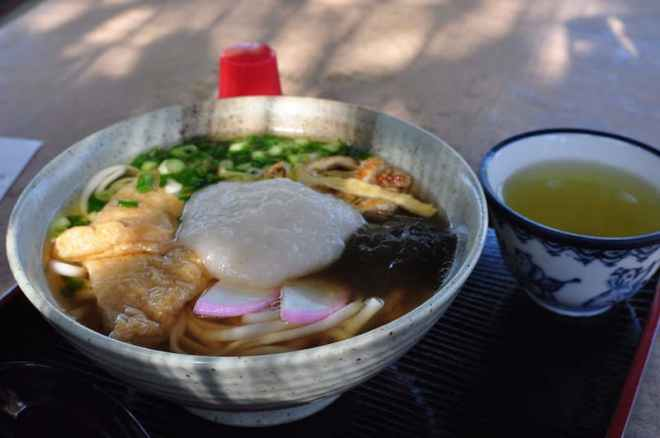 Udon noodles with mochi at To-no-oka Chaya next to the 5 storey pagoda on Miyajima in Hiroshima, Japan