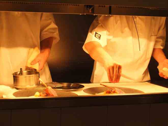Chefs put the finishing touches to a dish at Michelin starred restaurant Hiroto in Hiroshima, Japan