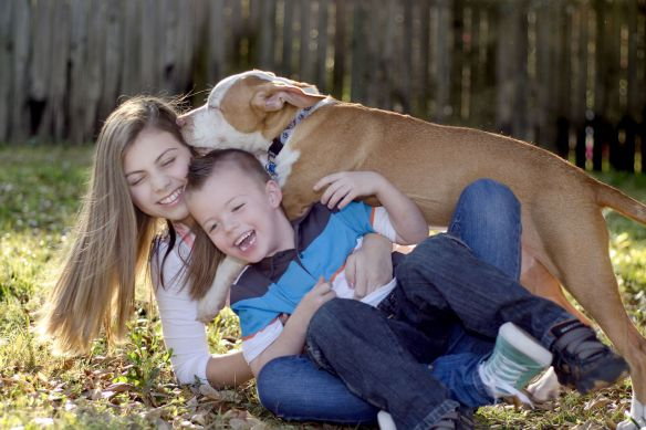 Delanie and Blake Thurber and one of their dogs.