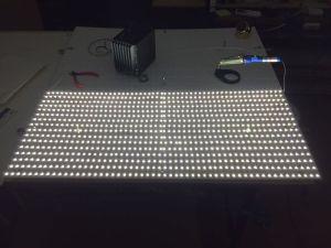半分くらい取り付けて、はんだ付けして点灯してみました。照明ムラを調べて見たら、板から30mm離れればムラは無くなります。エコライフフェアの時は、80mmさないといけなかったことを思うと、ずっと薄型になります!