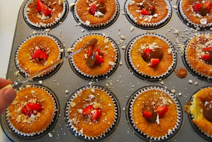 filling cupcakes with fruit