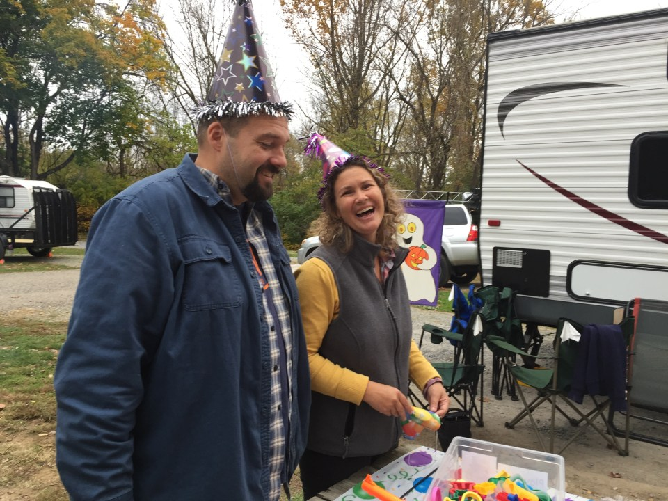 The podcast team of Stephanie and Jeremy Puglisi from RV Family Travel Atlas celebrating one year of podcasting at their rally last fall.