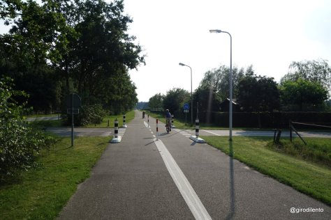 Cycle path priortiy over rural side roads - including bollards to keep cars out of cycle path
