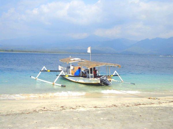 Boats bobbing off the beach of Gili Air