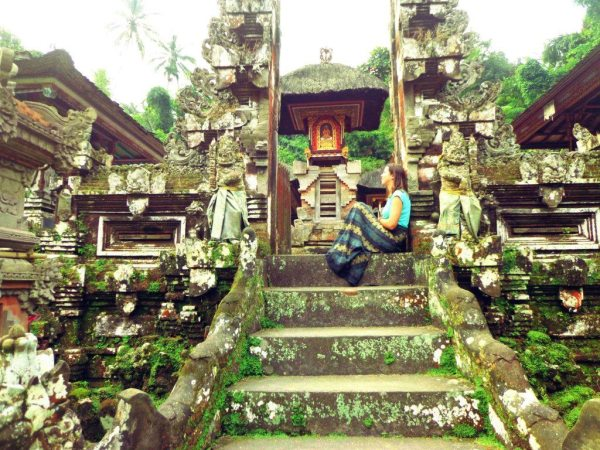 An image of Anna reflecting in a Balinese temple