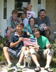 McGinty Family with Japanese Students and Flag