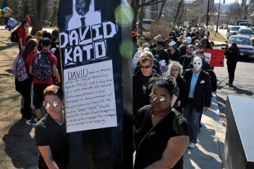 Demonstrators from Stop the Hate and Homophobia Coalition carry a mock coffin calling attention to slain Ugandan gay and lesbian rights leader David Kato during a protest in Springfield, Mass., Wednesday, March 14, 2012. Photo Credit: AP Photo/Springfield Republican, Don Treeger