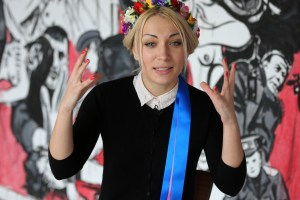 Ukrainian feminist group Femen leader Inna Shevchenko, answers questions from reporters during an interview with the Associated Press in a Paris suburb, Tuesday, Feb. 18, 2014. Photo Credit: AP Photo/Remy de la Mauviniere