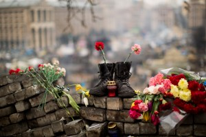 A pair of boots sit on top of a barricade at Independence Square, the epicenter of the country's current unrest, in Kiev, Ukraine,, Thursday, Feb. 27, 2014. Photo Credit: AP Photo/Emilio Morenatti