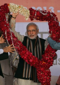 Narendra Modi, then chief minister of Gujarat,  in Ahmadabad, India, Saturday, Dec. 28, 2013. (AP Photo/Ajit Solanki)