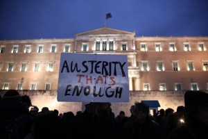 Pro-government protesters gather in front of Greece's parliament to back its demands of a bailout debt renegotiation in central Athens, Feb. 11, 2015. (AP Photo/Yorgos Karahalis)