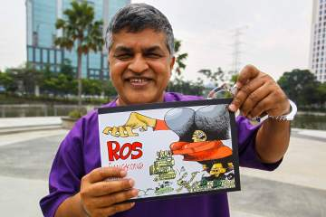 Malaysia political cartoonist launches satirical book