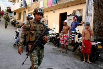 Colombian soldiers patrol the streets of the Comuna 13 suburbs prior to the presidential elections in Medellin, Colombia, May 24, 2014. (EPA/LUIS EDUARDO NORIEGA)