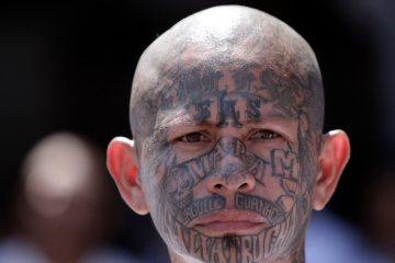 An inmate belonging to the Mara Salvatrucha or MS-13 gang stands inside the prison in Ciudad Barrios, El Salvador, March 26, 2012  (AP Photo/Luis Romero)