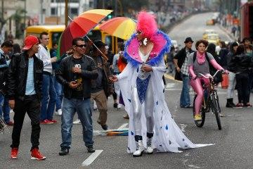 People attend a gay pride parade in Bogota, Colombia, June 30, 2013. (AP Photo/Fernando Vergara)
