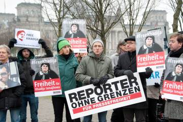 Demonstrators protest for freedom of the press and the release of political prisoners in Azerbaijan at the government district in Berlin, Germany, 21 January 2015. Reporters Without Borders called in for the protest on the occasion of Azerbaijani President Aliyev visit to Germany.  EPA/CLAUDIA KORNMEIER