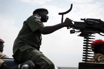 A government soldier mans a vehicle-mounted machine gun in the oil-rich town of Malakal, South Sudan, Feb. 24, 2015. (AP Photo/Jacob Zocherman)