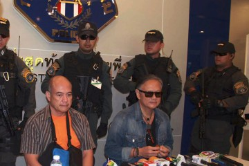Ex-municipal mayor, Mario Reyes, Left and Former Gov. Joel Reyes of western Palawan island province sits during a press conference at Crime Suppression Division in Bangkok, Thailand, Monday, Sept. 21, 2015. The former governor of a Philippine province and his brother who are wanted for the 2011 murder of a radio anchor and prominent environmentalist have been arrested in Thailand, officials said Monday. (AP Photo/Str)**Thailand Out**