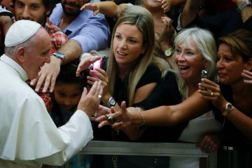 Pope Francis is cheered by faithful as he arrives in the Paul VI hall at the Vatican, Aug. 5, 2015.  (AP Photo/Gregorio Borgia)