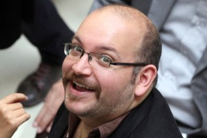 Jason Rezaian, an Iranian-American correspondent for the Washington Post, smiles as he attends a presidential campaign of President Hassan Rouhani in Tehran, Iran in April 2013.  (AP Photo/Vahid Salemi, File)
