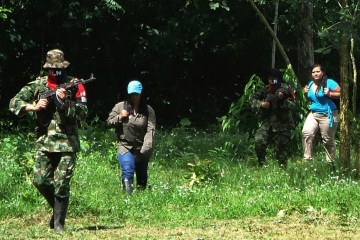 Members of the Colombian rebel group National Liberation Army, or ELN,  escort two female hostages during their release in the town of Fortul, northeast of Bogota, Colombia,  Aug. 13, 2012.  (AP Photo/Efrain Patino)