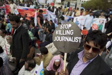 Pakistani journalists hold a sit-in protest before the Parliament demanding protection from the government to work in secured environment in Islamabad, Pakistan, Thursday, March 20, 2014. Dozens of Pakistani journalists have been killed on duty in the last couple of years. (AP Photo/B.K. Bangash)