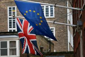 A EU flag hangs beside the Union Jack at the Europa House in London, Feb. 17, 2016.  (AP Photo/Frank Augstein)