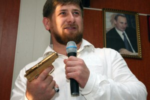 Chechen President Ramzan Kadyrov holds a golden Makarov pistol prior to presenting it to local Construction Minister Akhmed Gikhayev during a ceremony in the Chechen capital Grozny,  Aug. 21, 2007. (AP Photo/Musa Sadulayev)