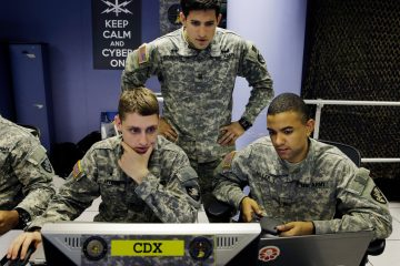 United States Military Academy cadets watch data on a computer at the Cyber Research Center at the United States Military Academy in West Point, N.Y., April 9, 2014. (AP Photo/Mel Evans)