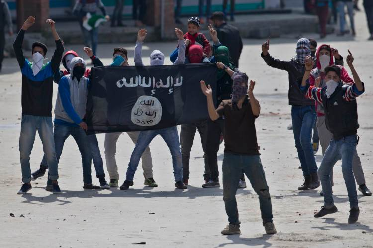 Kashmiri Muslim protesters hold a flag of Islamic State as they shout anti-India slogans during a protest in Srinagar, Indian controlled Kashmir, April 8, 2016. (AP Photo/Dar Yasin)