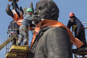 "Workers dismantle the 65-foot Lenin statue standing on the bank of the Dnieper River by the Dnieper Hydroelectric Station as part of Ukraine's ""decommunization,"" removal or changing names of all Soviet-era communist symbols, March 16, 2016. The statue was taken down the following day. (Frank Folwell)"