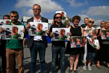 "Protesters, including Reporters Without Borders' Secretary General  Christophe Deloire, holding pictures of RSF local representative Erol Onderoglu, academic Sebnem Korur Fincanci and journalist Ahmet Nesin, demonstrate against their jailing, outside Metris prison where Onderoglu and Nesin are held, in Istanbul, Friday, June 24, 2016. Onderoglu, along with Nesin and Fincanci, who had participated in a solidarity campaign in support of a pro-Kurdish publication, already subject to multiple investigations and lawsuits, were placed in pretrial arrest by a Turkish court Monday over charges of disseminating ""terrorist propaganda"". Press freedom advocates warn that freedom of expression has dramatically declined in Turkey, where lawsuits against journalists, academics and other public figures are common.(AP Photo/Lefteris Pitarakis)"
