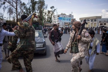 Houthis do a traditional dance at a tribal meeting to gather money and bullets in Sana'a. (EPA/ Asmaa Waguih)