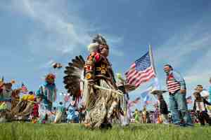 Members of the Standing Rock Sioux Tribal Nation, dance during a Cannon Ball flag day celebration, at the Cannon Ball powwow grounds in Cannonball, N.D, June 13, 2014. (AP Photo/Manuel Balce Ceneta)