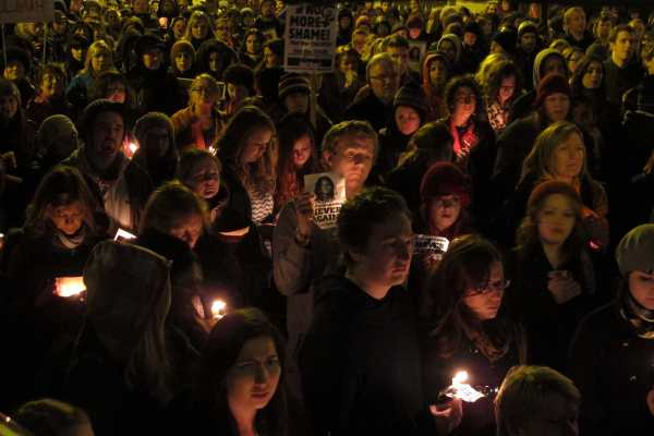 Abortion rights activists hold candles and display pictures in memory of Savita Halappanavar, a 31-year-old Indian dentist who died of blood poisoning after being denied an abortion in a Dublin hospital, during a protest rally outside Ireland's government headquarters in Dublin, Nov. 17, 2012. (AP Photo/Shawn Pogatchnik, file)
