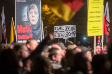 Supporters of right-wing anti-foreigner Alternative for Germany (AfD) party protest against German asylum policy in Erfurt, Germany, Oct. 28, 2015. (EPA/Michael Reichel)