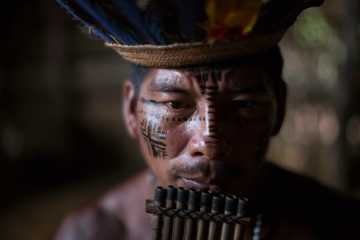 A man plays the flute in the Tatuyo indigenous community near Manaus, Brazil in May 2014. (AP Photo/Felipe Dana)