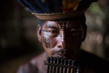 A man plays the flute in the Tatuyo indigenous community near Manaus, Brazil in May 2014. (AP Photo/Felipe Dana)
