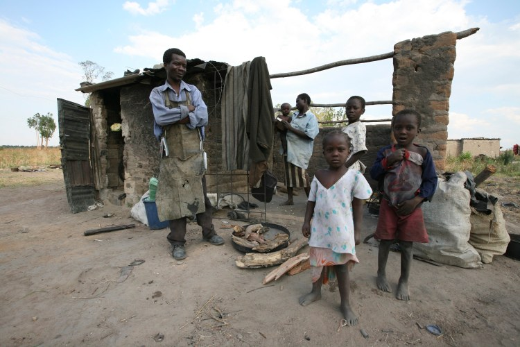 Phai Munaingo, left who lives with his family of four children in a one room makeshift home in Epworth, near Harare, Zimbabwe, pictured in October 2008 during Zimbabwe's last bout with hyperinflation. (AP Photo/Tsvangirayi Mukwazhi)