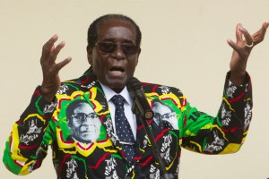Zimbabwean President Robert Mugabe addresses people at an event before the closure of his party's 16th Annual Peoples Conference in Masvingo, south of the capital Harare, Dec. 17, 2016. (AP Photo/Tsvangirayi Mukwazhi, File)