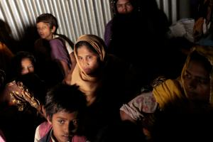 Rohingya from Myanmar who recently crossed over to Bangladesh, huddle in a room at an unregistered refugee camp in Teknaf, near Cox's Bazar, a southern coastal district about, 296 kilometers (183 miles) south of Dhaka, Bangladesh, Dec. 2, 2016. (AP Photo/A.M. Ahad)