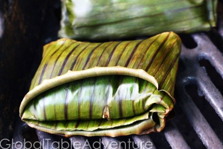 Goat in Banana Leaves with Spicy Peanut Sauce | Global Table Adventure