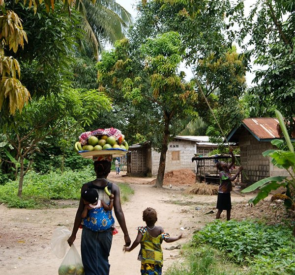 Woman and child in Mile 91, Sierra Leone. Photo by Annabel Symington.