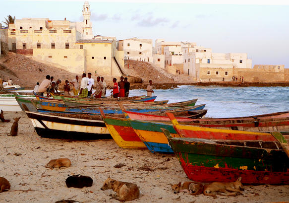 Boats on the beach in Merca, Somalia. -tahir turk